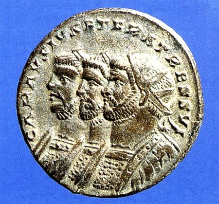 One side of a Roman Coin deicptiing from right to left: Carausius, Diocletian, and Maximian