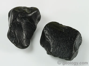Two irregular pieces of Whitby jet pieces