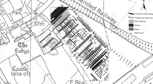 A greyscale plan orientated North with a extract from a geophysical survey overlain onto a map of Malton - this shows a very concentrated arrangement of earth ramparts, ditches, and roads - this plan also shows street names such as Old Maltongate, and buildings such as The Lodge, and includes an illustration and label marking a 'Dismantled Railway' along the North side